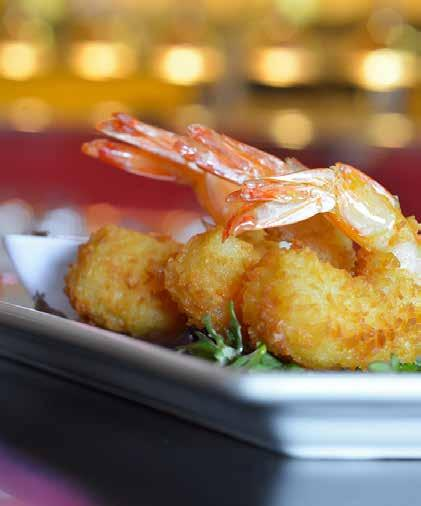 Hors D oeuvres HOT CRAB CAKES house made crab cakes topped with a kiss of creamy garlic tartar sauce TORPEDO SHRIMP coated with tempura and fried golden brown YUKON GOLD POTATO PUFFS mashed yukon
