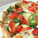 Gourmet Vegetarian Pizza Serves: 4 Prep time: 10 mins Cook time: Varies 1 unbaked pizza crust 1 recipe Creamy Garlic Sauce (see recipe below) Fresh spinach Sliced zucchini Mushrooms Artichoke hearts