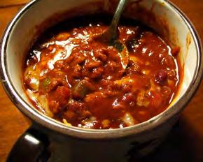 Chili Soup Serves: 6 Serving Size: 1½ cups 1 pound 90% lean ground beef 1 small onion*, chopped (~1/2 cup) 1 medium green pepper, chopped (~1/2 cup) 1 can corn* (14-16 ounces) 1 can stewed tomatoes