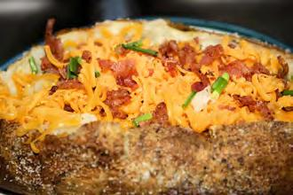 Loaded Baked Potatoes Serves: 8 Serving Size: 1/2 potato with topping 4 baking potatoes (½ pound each) 1 pound 90-95% lean ground beef or turkey ½ teaspoon garlic powder ½ teaspoon onion powder 1 cup
