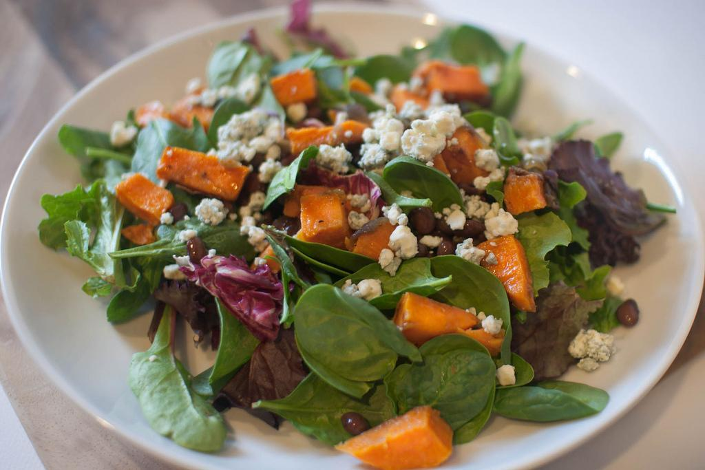 Roasted Sweet Potato Salad with Mixed Greens Serves: 2 Ingredients 3 cups mixed salad greens 1 small sweet potato ½ red onion, diced ½ tablespoon olive oil Canned black beans Balsamic vinaigrette