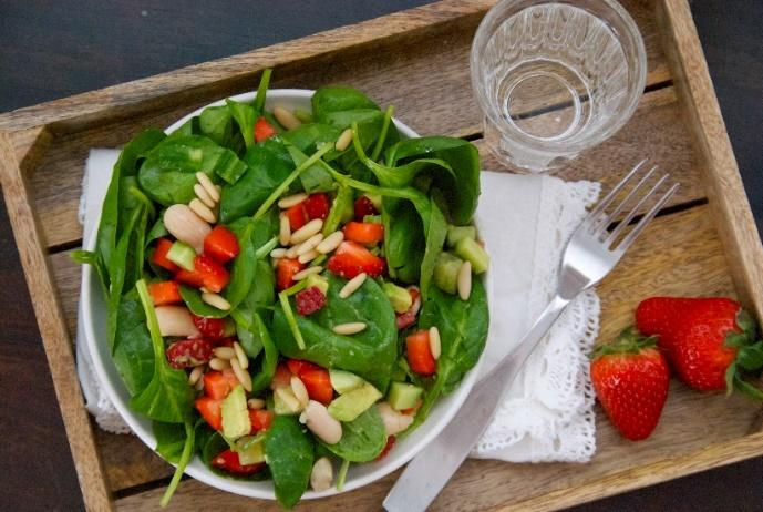 Spinach and Strawberry Salad with Basil, Mint Dressing [Serves 2] 4 cups baby spinach 1 cup chopped strawberries 1 cucumber, diced 1 avocado, diced ½ cup white beans, drained and rinsed ¼ cup