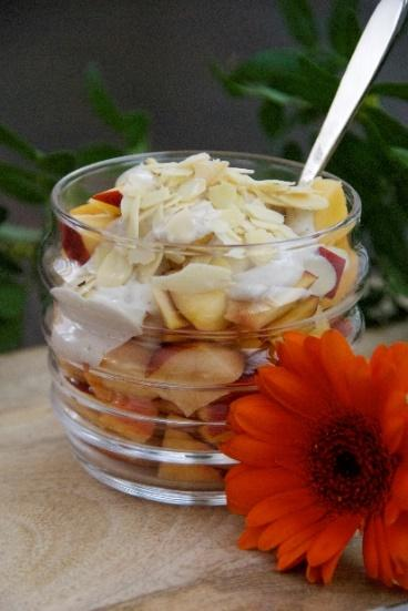 Treats Peaches with Warmed Coconut Butter [Serves 2] 1 ½ cups peaches ¼ cup coconut butter 2 tablespoons sliced almonds Put the