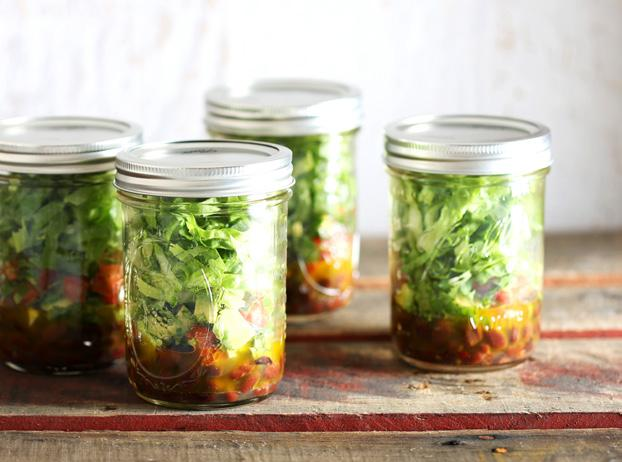 Mexican Mason Jar Salads The secret to keeping this on-the-go salad fresh is to keep the dressing at the bottom and the greens at the top.