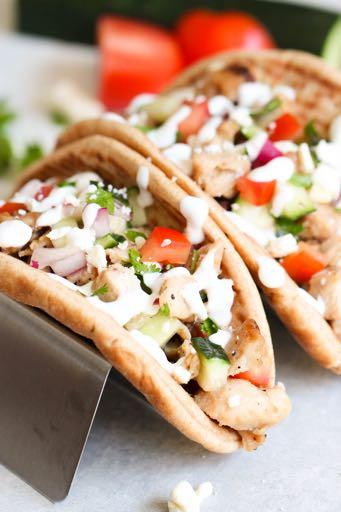 DAY 7 SMALLER FAMILY- MEDITERRANEAN CHICKEN PITA TACOS M A I N D I S H Serves: 4 Prep Time: 10 Minutes Cook Time: 2 cups grilled chicken (cooked and diced) 1 roma tomato (diced) 1/2 cucumber (diced)