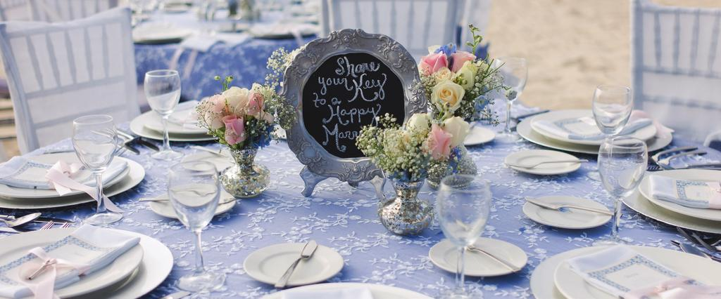 Reception Table Décor: 5 foot round table that seats 8 people Blue stone table cloth with white lace overlay 8 silver chiavari chairs 8 coordinated chair covers, chair bands and