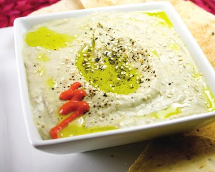 Hummus $8 Chickpeas, tahini paste and virgin olive oil blended together. Served with Greek pita or tortilla chips. 4.