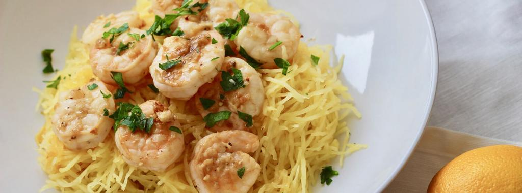 Lemon Garlic Shrimp Spaghetti Squash 7 ingredients 45 minutes 2 servings 1. Preheat oven to 350F and line a baking sheet with parchment paper. 2. Slice the spaghetti squash in half through its belly, and place cut-side down on the baking sheet.
