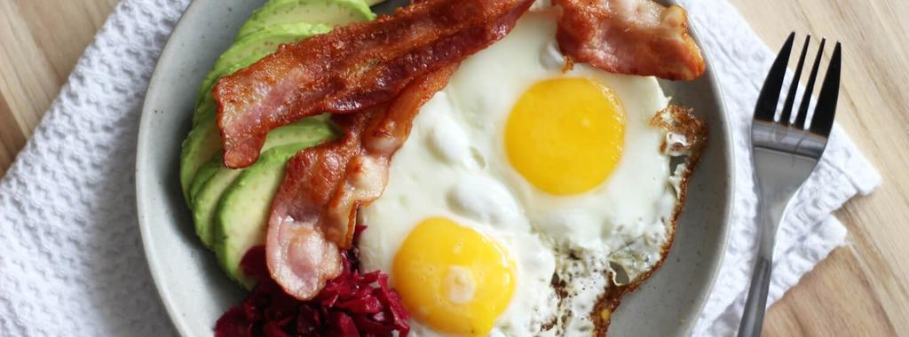 Bacon, Eggs, Avocado & Sauerkraut 4 ingredients 15 minutes 4 servings 1. In a pan, slowly cook the bacon over medium-low heat until done. Transfer to a plate and reserve fat for cooking eggs. 2.