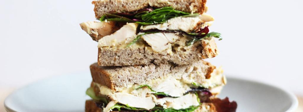 Turkey Hummus Sandwich 5 ingredients 5 minutes 4 servings 1. Lightly toast the bread. 2. Spread one slice of the bread with hummus and mustard. Layer on the turkey and mixed greens.