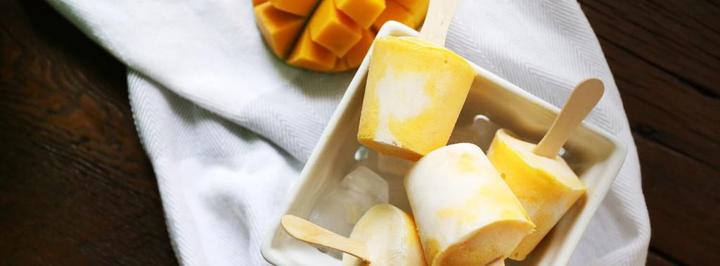 Mango Coconut Popsicles 2 ingredients 40 minutes 16 servings 1. Blend mango and 3/4 of the coconut milk in a food processor or blender until smooth. 2. Roughly scoop mango puree into 3oz. paper cups.