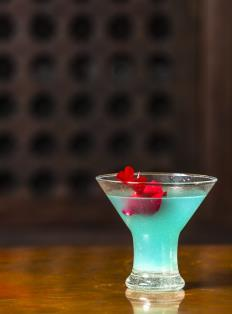AQUA MEDINA A sparkling blue martini of Absolut Lychee and citrus.