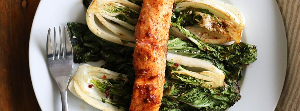One Pan Honey Garlic Salmon with Bok Choy 10 ingredients 20 minutes 4 servings 1. Preheat oven to 510 and line a baking sheet with parchment paper. 2. In a bowl, whisk together the honey, half of the tamari, minced garlic and chili powder.