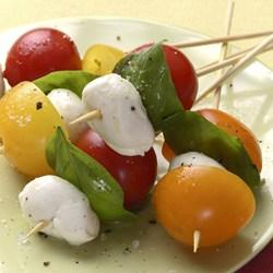 Appetizers and Snacks Caprese Skewers 16 small fresh mozzarella balls 16 fresh basil leaves 16 cherry