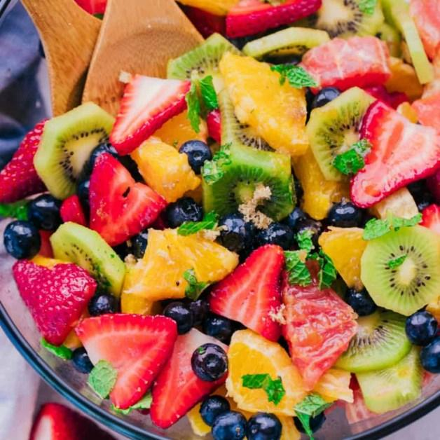Fruit Salad 1 pint strawberries sliced 5 kiwis sliced 5 oranges peeled and diced 2 grapefruit peeled and diced 12 ounces blueberries 1 cup Mint chopped and divided 1/2 cup Orange juice (or juice from