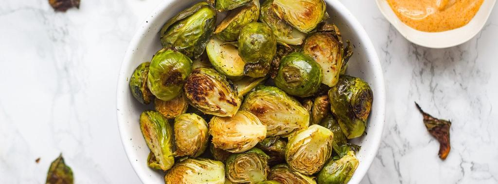 Crispy Brussels Sprouts with Dip 6 ingredients 35 minutes 4 servings 1. Preheat your oven to 425ºF (218ºC). Line a baking sheet with parchment paper and add the brussels sprouts.