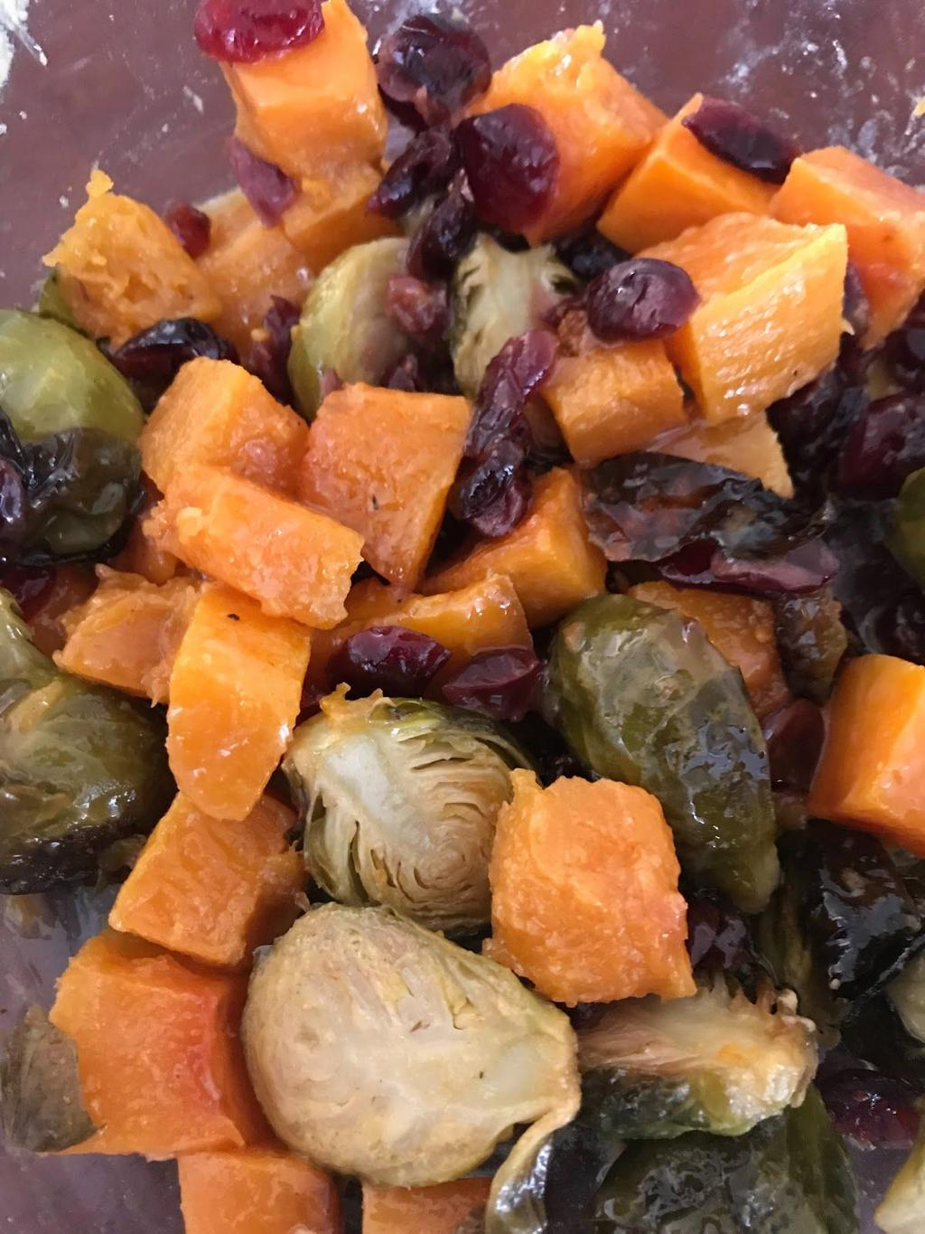 Butternut Squash, dried cranberry and brussel sprout side 1 Pound brussel sprouts, cut in half 1 Pound butternut squash, cut into cubes ¼ cup dried cranberries 4 tablespoons Olive oil 1 Tablespoon