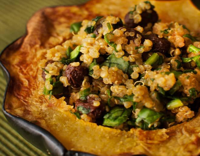 Stuffed Acorn Squash From Happy Herbivore Abroad 2 acorn squash 1 cup uncooked quinoa 2 1/2 cups low-sodium vegetable broth 1 teaspoon mild curry powder ground cinnamon 1/2 cup raisins 2 cups finely