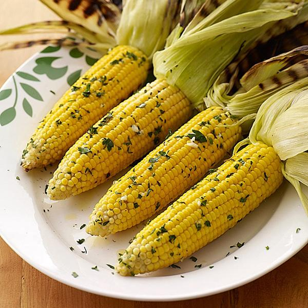 GRILLED CORN ON THE COB w/ Garlic Butter 8 ears corn 4 fresh limes, quartered Garlic butter, recipe follows 1/2 cup parmesan cheese Preheat grill to medium.