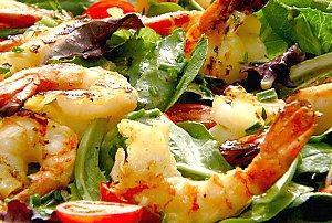 Citrus Grilled Shrimp over Greens 1 pound large raw shrimp, peeled and deveined (leave tail on for presentation) 1/3 cup orange juice 1 tablespoon lime juice 2 teaspoons olive oil 2 teaspoons Dijon