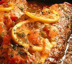 Creole Flounder 2 pounds flounder or other mild flavored fish fillets 2 medium tomatoes, chopped (1 1/2 cups) 1 small green bell pepper, chopped (1/2 cup) 1/3 cup lemon juice 2 teaspoons extra virgin