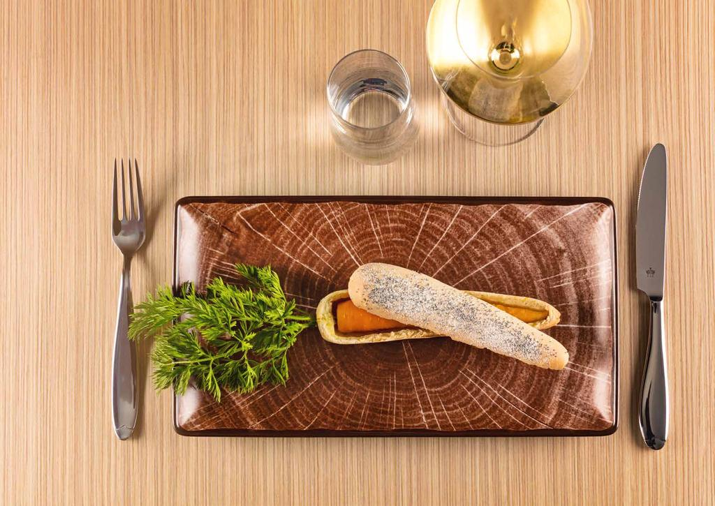 WOODART CASUAL DINING 111 En WOODART conveys the strength of wood in a soft, glossy material, inviting you to relaxation.