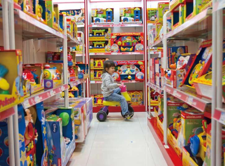Ecology A child blissfully unaware of the potential danger on the shelves Toying With Safety?