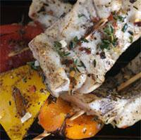 Grilled Barramundi Skewers Serves: 4 Prep Time: 8 Cook Time: 2 4 Barramundi Fillets 2 Bell Peppers- Red, Yellow or Green, as desired (cut into large chunks) ½ Cup Extra Virgin Olive Oil 1 Tbs.