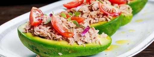 Tuna Boats 9 ingredients 5 minutes 1 serving 1. Cut avocados in half lengthwise and remove the stone leave the peel on. In a large mixing bowl mix together the tuna, celery, onions, mayo and spices.