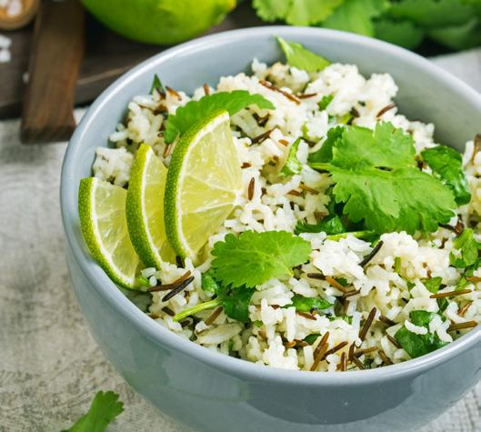 CILANTRO BUTTER LIME RICE 18 2 cups water 1 tablespoon butter 1 cup long-grain white rice 1 teaspoon lime zest 2 tablespoons fresh lime juice 1/2 cup chopped cilantro Bring the water to a boil; stir